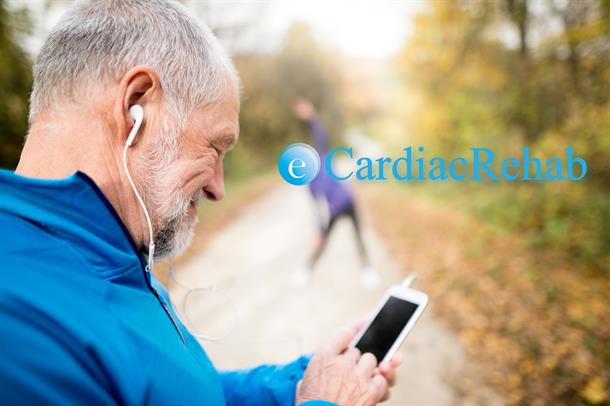 Man jogging and watching his mobile. Photo